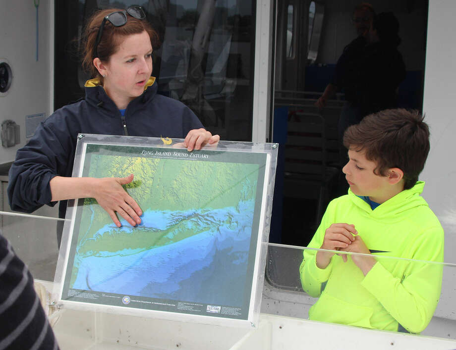 Hour photo/Chris Bosak Maritime Aquarium at Norwalk educator Lauren Magliola gives an overview of Long Island Sound during a research cruise aboard the new RV Spirit of the Sound on Saturday.