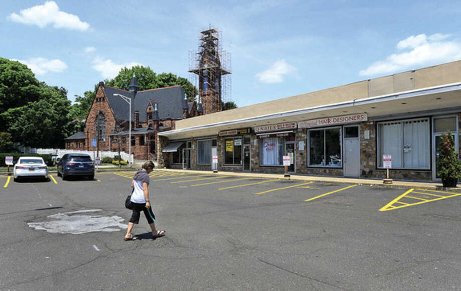 Hour photo/Erik TrautmannThe Norwalk Common Council on Tuesday tabled action on granting easement through corner of Webster Lot to create a new entrance for private parking adjacent to the building at 64-84 North Main.