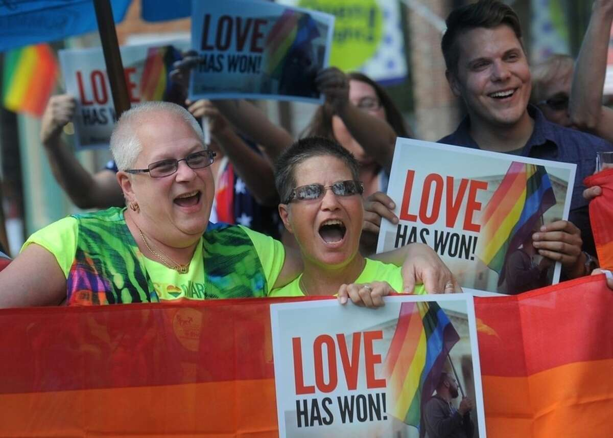 Lynn and Monica Serling Swank celebrate marriage equality outside of Lucky's in downtown Sioux Falls, S.D. on Friday, June 26, 2015. The U.S. Supreme Court legalized marriage for same-sex couples in all 50 states. (Travis Heying/The Argus Leader via AP) NO SALES
