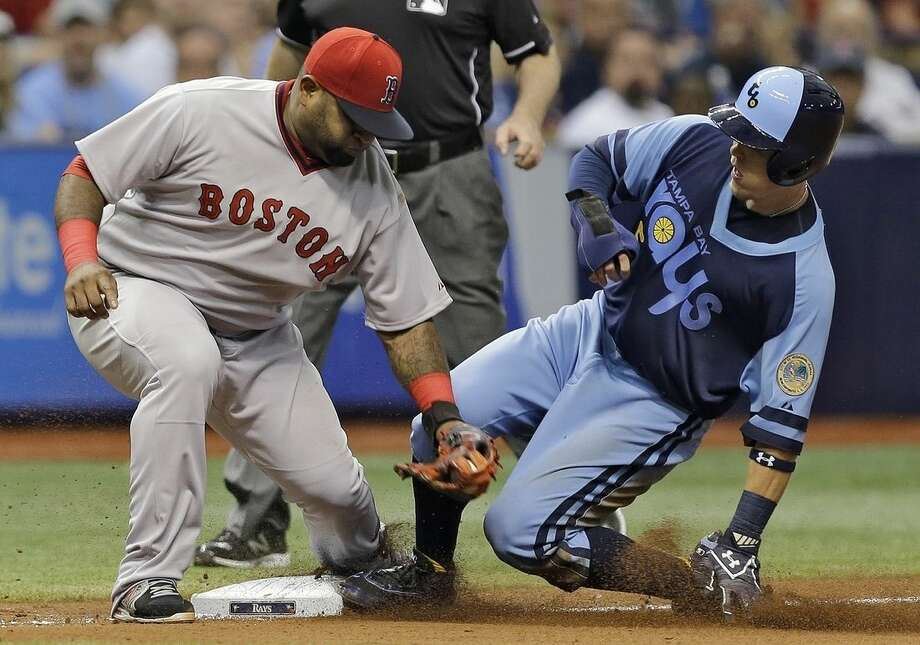 Tampa Bay Rays' Brandon Guyer, right, beats the tag by Boston Red Sox third baseman Pablo Sandoval as he steals third during the seventh inning of a baseball game Saturday, June 27, 2015, in St. Petersburg, Fla. (AP Photo/Chris O'Meara)