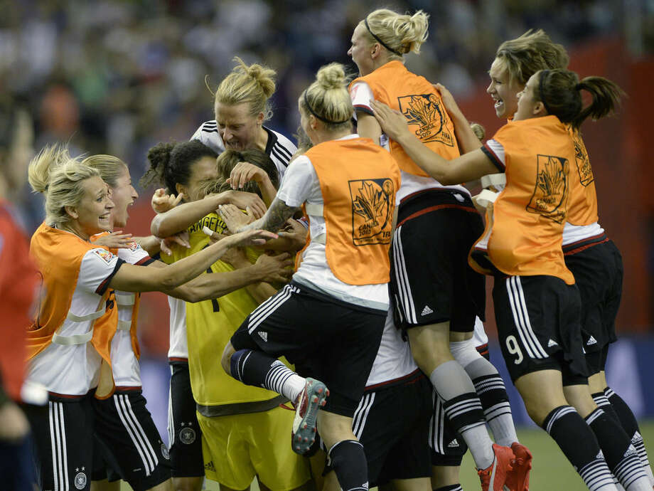 Germany goalkeeper Nadine Angerer (1) celebrates with teammates after making a save against France's Claire Lavogez during a shootout at a FIFA Women's World Cup quarterfinal soccer match in Montreal, Canada. (Ryan Remiorz/The Canadian Press via AP) MANDATORY CREDIT