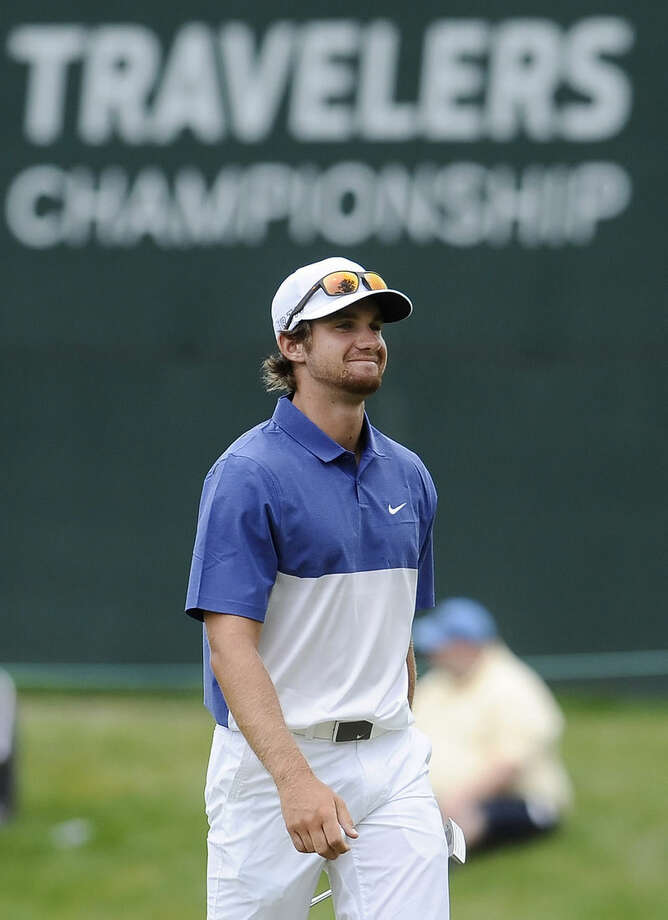 Patrick Rodgers reacts to a birdie putt on the 17th hold during the third round of the Travelers Championship golf tournament, Saturday, June 27, 2015, in Cromwell, Conn. Rodgers finished 7 under par for the day. (AP Photo/Jessica Hill)