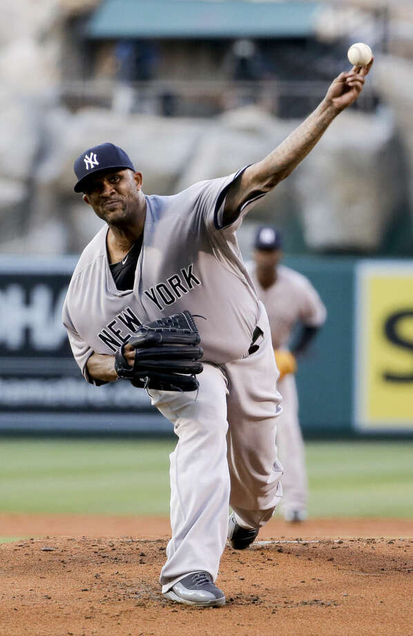 New York Yankees starting pitcher CC Sabathia throws against the Los Angeles Angels during the first inning of a baseball game in Anaheim, Calif., Monday, June 29, 2015. (AP Photo/Chris Carlson)