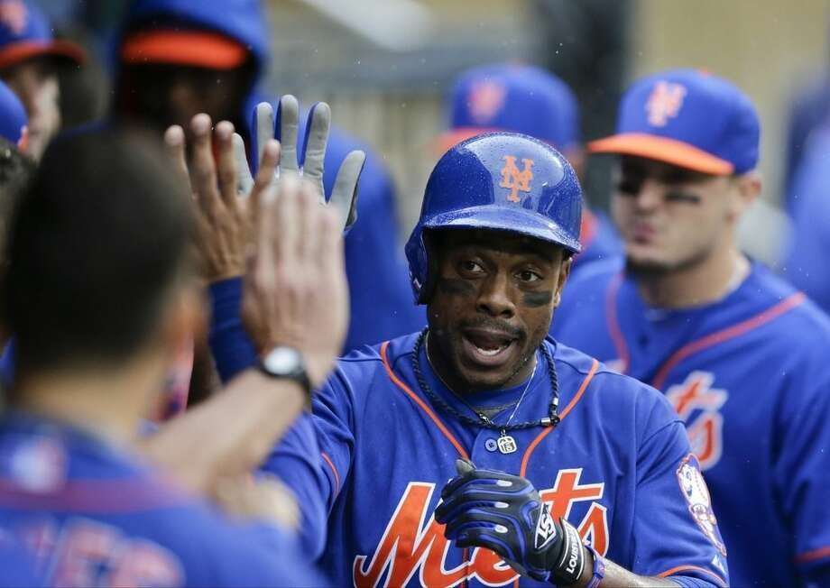 New York Mets' Curtis Granderson celebrates with teammates after hitting a home run during the third inning of a baseball game against the Cincinnati Reds, Saturday, June 27, 2015, in New York. (AP Photo/Frank Franklin II)