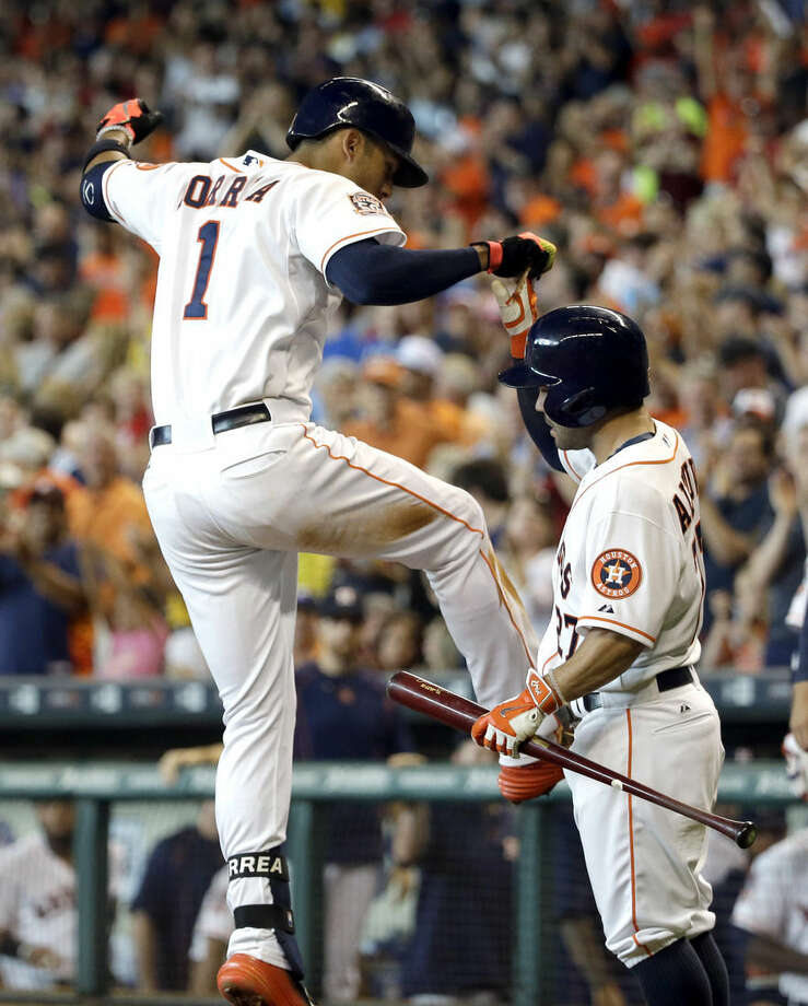 Houston Astros' Carlos Correa (1) celebrates his two-run home run with teammate Jose Altuve, right, during the fifth inning of a baseball game against the New York Yankees, Saturday, June 27, 2015, in Houston. (AP Photo/David J. Phillip)