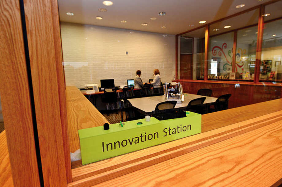 The new Innovation Station room at Wilton Library houses different tools and resources for group learning, including a 3-D printer.