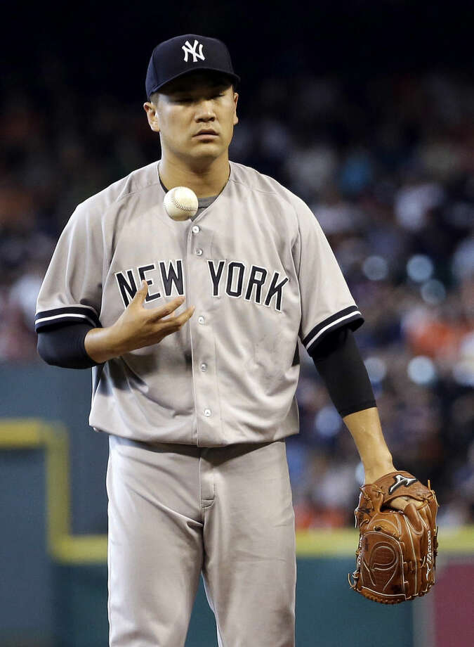 New York Yankees starting pitcher Masahiro Tanaka waits to throw after giving up a home run to Houston Astros' Chris Carter during the fourth inning of a baseball game Saturday, June 27, 2015, in Houston. (AP Photo/David J. Phillip)