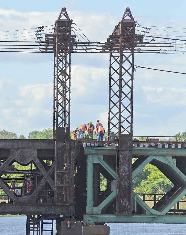 """Hour photo / Harold CobinMetro-North workers try to fix the """"Walk Bridge"""" that malfunctioned for the second time in eight days Friday afternoon."""