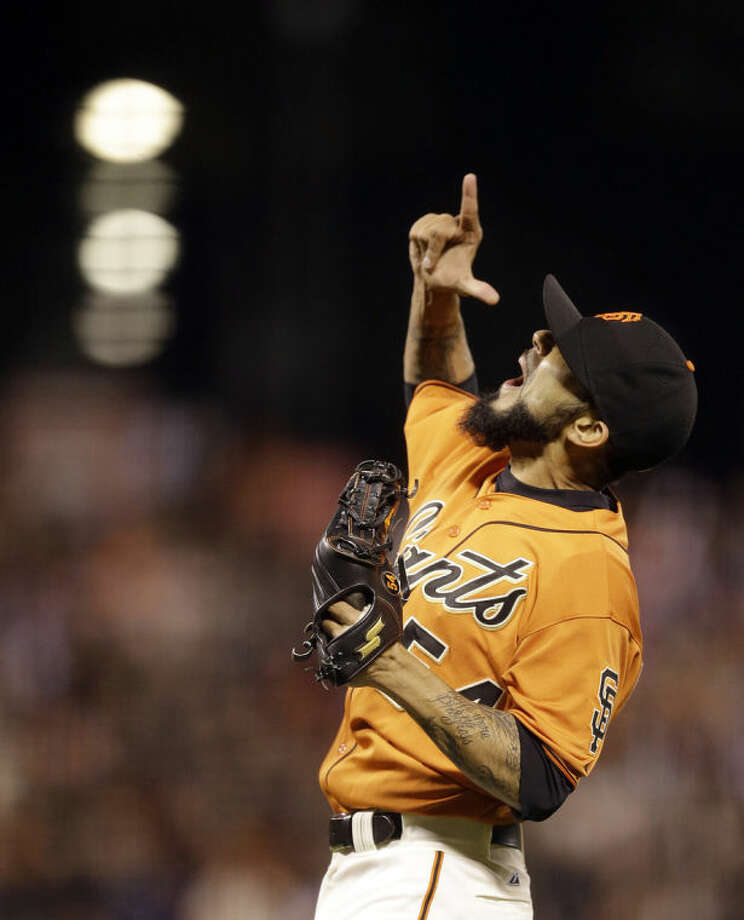 San Francisco Giants' Sergio Romo celebrates as the final out is made against the New York Mets at the end of a baseball game Friday, June 6, 2014, in San Francisco. (AP Photo/Ben Margot)