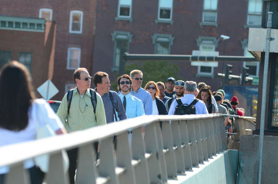 Hour photo / Harold CobinCommuters walk over the Stroffolino Bridge due to the Metro-North service shutdown.
