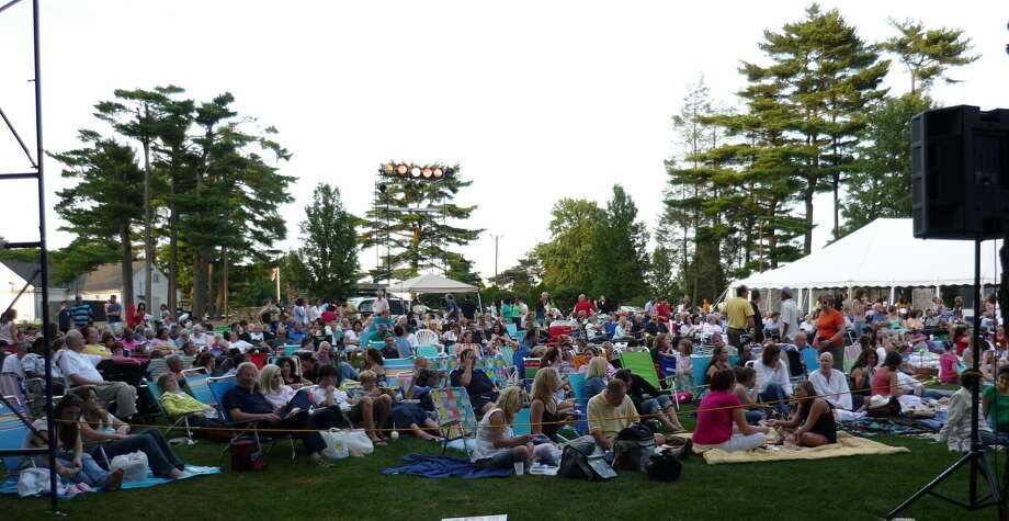 Patrons of all ages gather on the lawn for a presentation of a Shakespearean classic at Curtain Call's annual Shakespeare on the Green program.