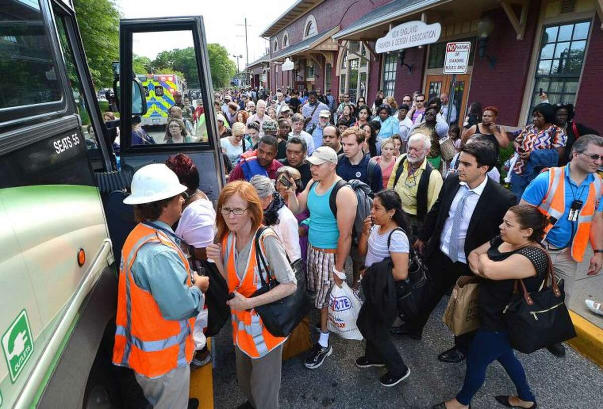 Hour Photo/Alex von Kleydorff Metro North passengers are loaded onto buses at the Eastbound side of the South Norwalk Train Station after the railroad swing bridge spanning the Norwalk River failed again stranding thousands of Friday Rush Hour riders