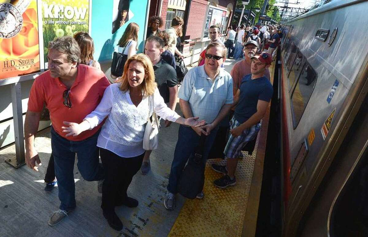 Hour Photo/Alex von Kleydorff Metro North passengers are given conflicting direction to trains and buses on the eastbound platform of the South Norwalk Train Station after the railroad swing bridge spanning the Norwalk River failed again stranding thousands of Friday Rush Hour riders