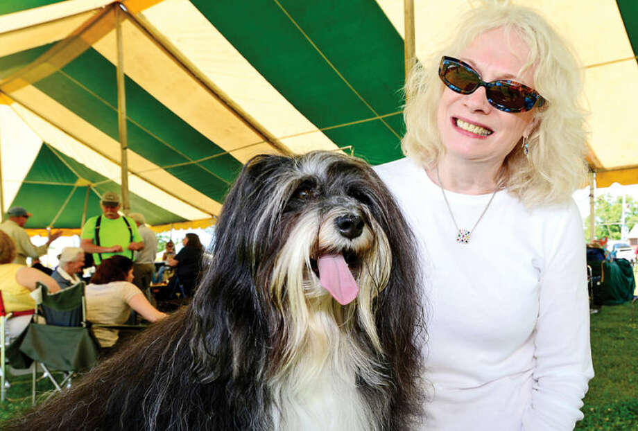 Hour photo / Erik Trautmann Patricia Wann and her Havanese, Topper, wait to compete in The Greenwich Kennel Club All-Breed Dog Show, Obedience & Rally Trial at Taylor Farm Saturday,