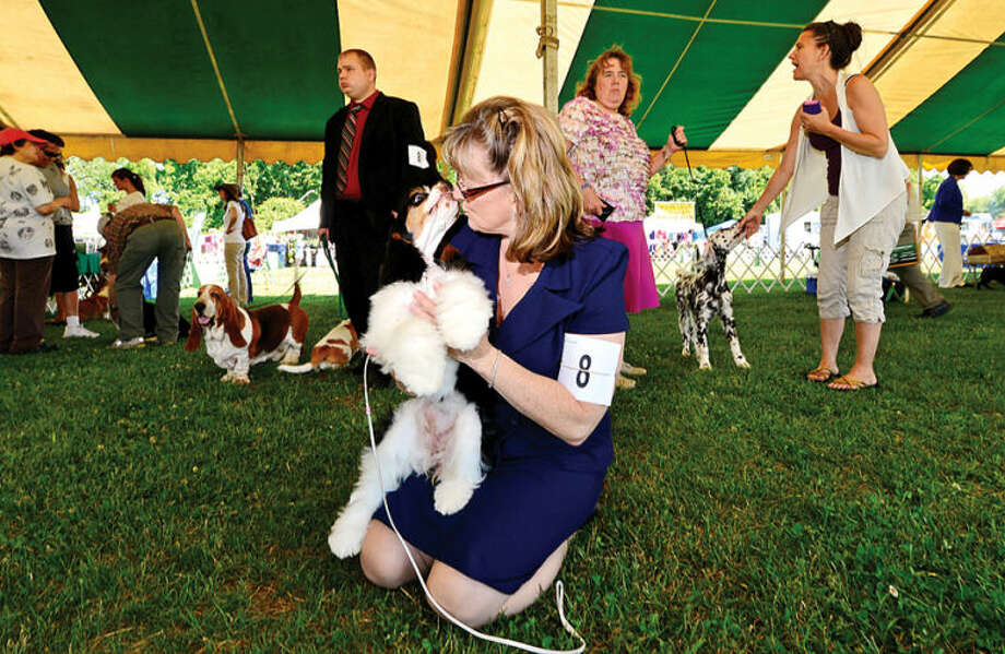 Hour photo / Erik Trautmann Lisa Gaeretner thanks her America Cocker Spaniel , Kelly, after competing in The Greenwich Kennel Club All-Breed Dog Show, Obedience & Rally Trial at Taylor Farm Saturday,