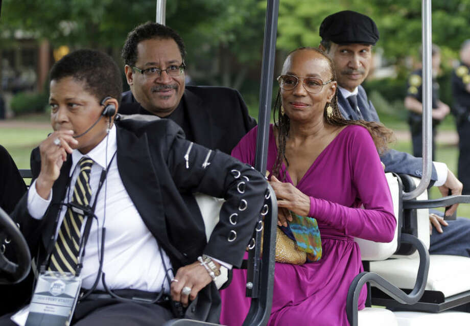 Michael Eric Dyson, second from left, and Susan L. Taylor, second from right, arrive outside Wait Chapel before a memorial service for poet and author Maya Angelou at Wait Chapel. at Wake Forest University in Winston-Salem, N.C., Saturday, June 7, 2014. Former President Bill Clinton and Oprah Winfrey are joining First Lady Michelle Obama at the service. (AP Photo/Chuck Burton)