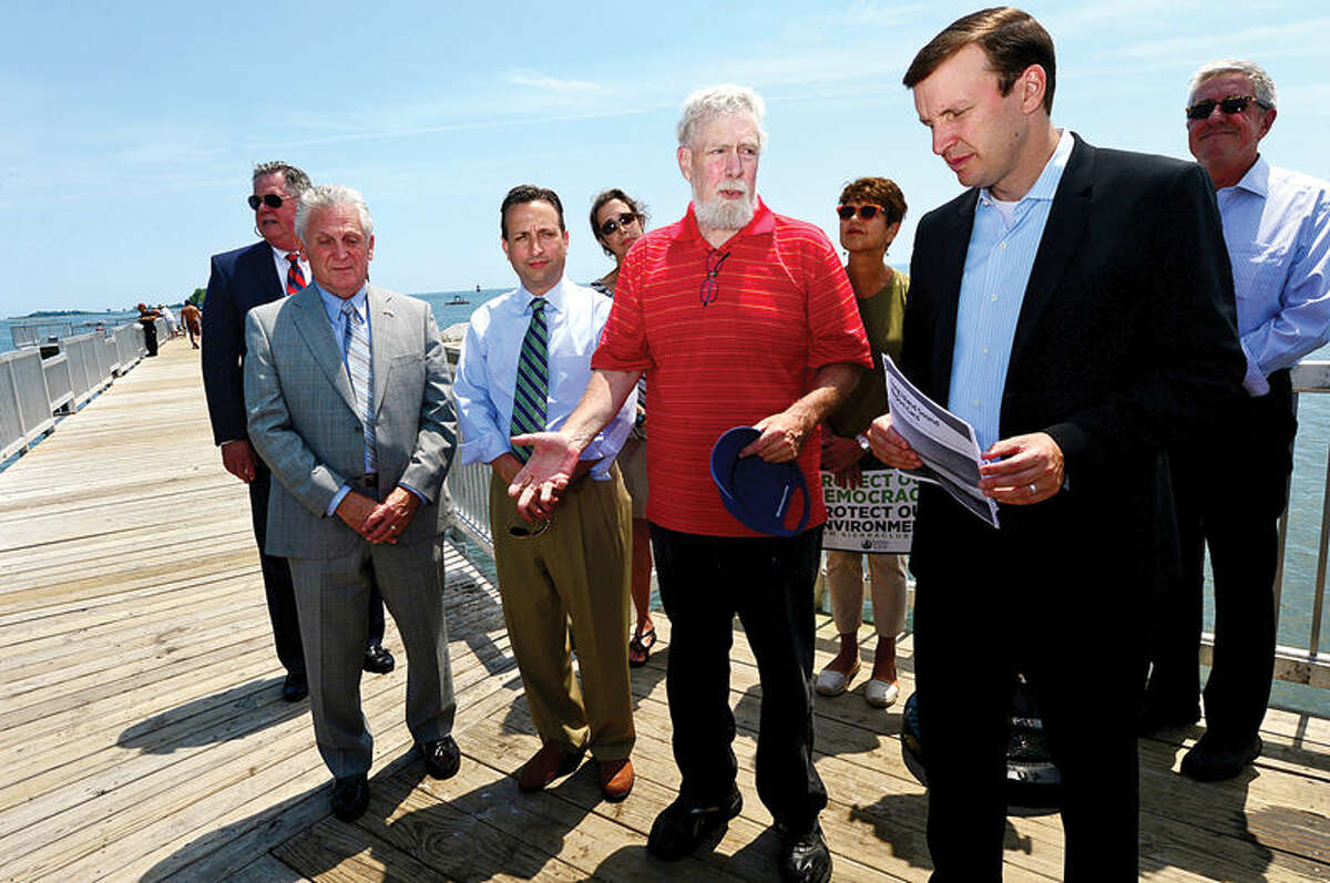 Hour photo / Erik Trautmann Long Island Soundkeeper and State Representative Terry Backer, speaks as U.S. Senator Chris Murphy stopped at Calf Pasture Beach fishing pier Tuesday as part of a listening tour to discuss ways to preserve Long Island Sound. Senator was joined by environmental and business advocates urging the passage of legislation protecting the Sound.