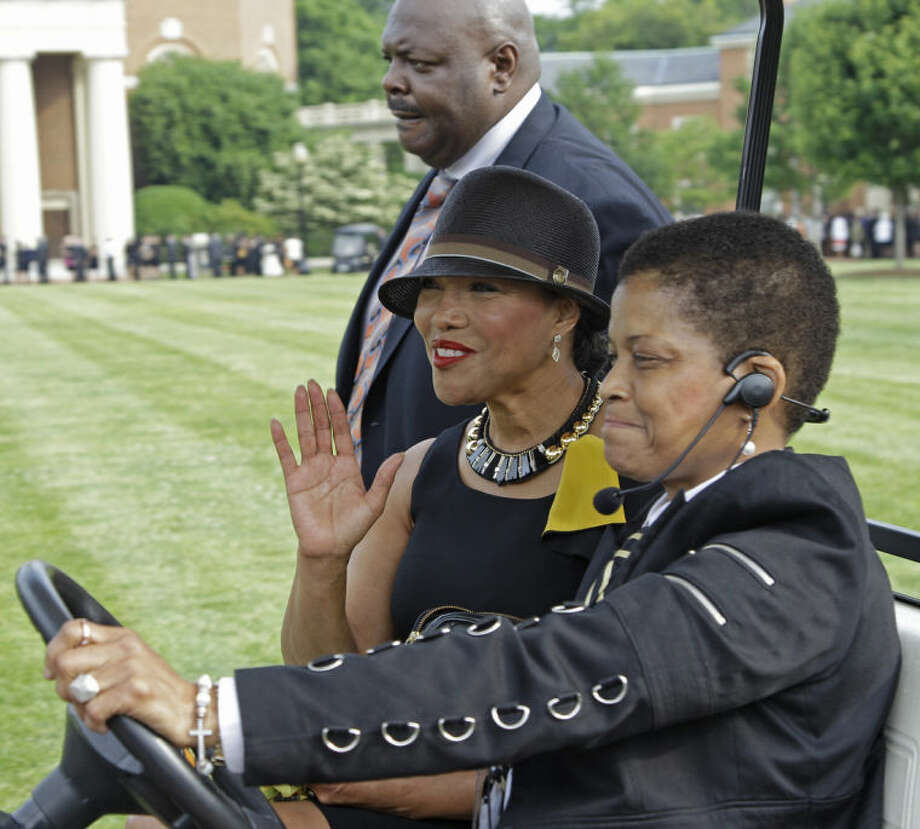 Actress Lynn Whitfield, center, waves as she arrive outside Wait Chapel before a memorial service for poet and author Maya Angelou at Wait Chapel. at Wake Forest University in Winston-Salem, N.C., Saturday, June 7, 2014. Former President Bill Clinton and Oprah Winfrey are joining First Lady Michelle Obama at the service. (AP Photo/Chuck Burton)