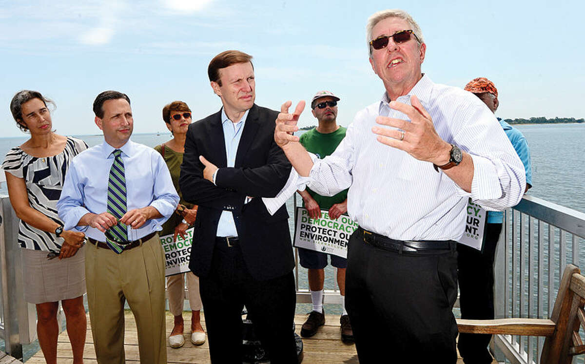 Hour photo / Erik Trautmann Curtis Johnson, Executive Director of Save the Sound, speaks as U.S. Senator Chris Murphy stopped at Calf Pasture Beach fishing pier Tuesday as part of a listening tour to discuss ways to preserve Long Island Sound. Senator was joined by environmental and business advocates urging the passage of legislation protecting the Sound.
