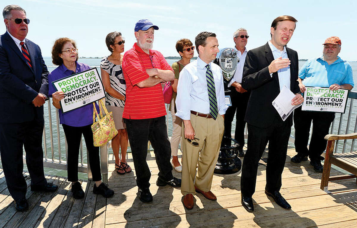 Hour photo / Erik Trautmann U.S. Senator Chris Murphy stops at Calf Pasture Beach fishing pier Tuesday as part of a listening tour to discuss ways to preserve Long Island Sound. Senator was joined by environmental and business advocates urging the passage of legislation protecting the Sound.