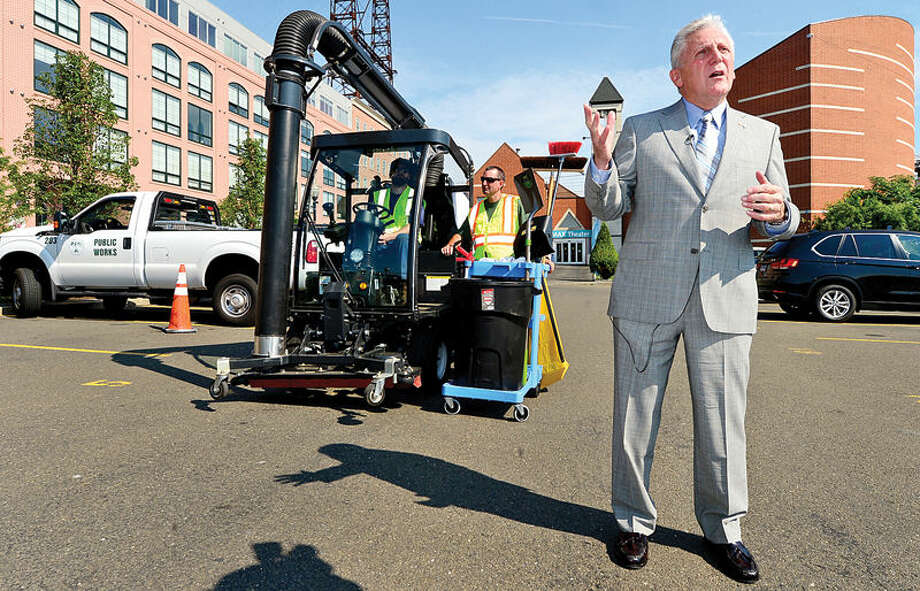 Hour photo / Erik Trautmann Mayor Harry Rilling announces additions to his Clean Street Initiative as public works employees demonstrate the Madvac compact sweeper and vacuum Tuesday in front of IMAX/Seaport Dock on North Water.