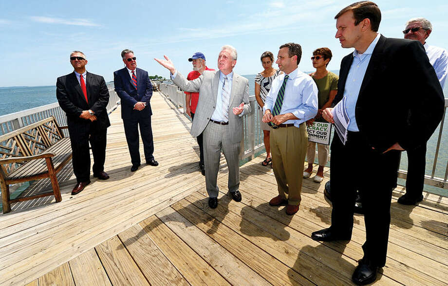 Hour photo / Erik Trautmann Norwalk Mayor Harry Rilling speaks as U.S. Senator Chris Murphy stopped at Calf Pasture Beach fishing pier Tuesday as part of a listening tour to discuss ways to preserve Long Island Sound. Senator was joined by environmental and business advocates urging the passage of legislation protecting the Sound.