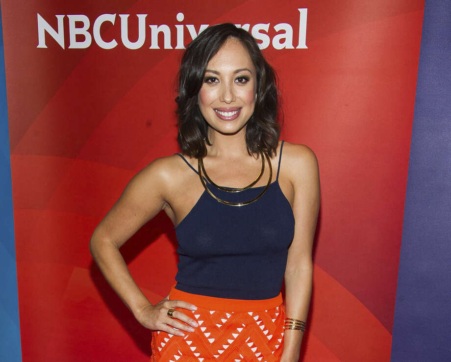"FILE - In this June 24, 2015 file photo, Cheryl Burke arrives at the NBCUniversal New York Summer Press Day event at The Four Seasons Hotel in New York. Miss USA has lost its third co-host. ""Dancing with the Stars'"" Cheryl Burke said Tuesday, June 30, she is dropping out of next month's pageant ""in light of the recent statements made by Donald Trump,"" a co-owner of the pageant. Burke was scheduled to join MSNBC anchor Thomas Roberts co-hosting NBC's telecast of the July 12 event. (Photo by Charles Sykes/Invision/AP, File)"
