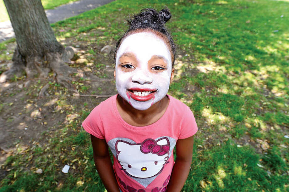 Hour photo / Erik Trautmann Diamond Wilson gets her face painted during Rev. Ray Dancy's Youth Council for Justice Family Fun Day in Ryan Park Saturday.