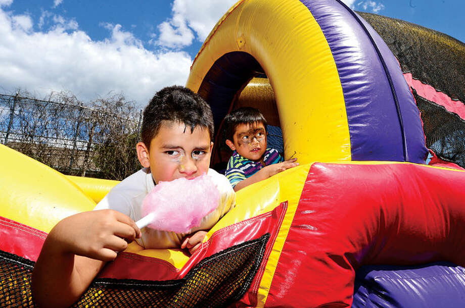 Hour photo / Erik Trautmann Cesar Arias 7 and Jefferson Gonzales, 2, play during Rev. Ray Dancy's Youth Council for Justice Family Fun Day in Ryan Park Saturday.