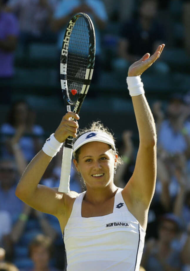 Jana Cepelova of Slovakia celebrates after defeating Simona Halep of Romania in their singles first round match at the All England Lawn Tennis Championships in Wimbledon, London, Tuesday June 30, 2015. Cepelova won the match 5-7, 6-4, 6-3. (AP Photo/Kirsty Wigglesworth)