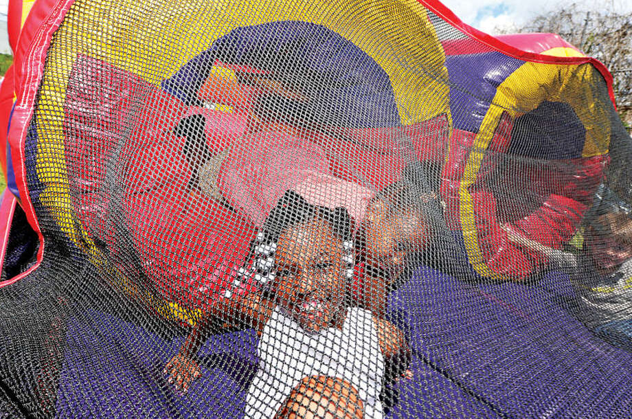 Hour photo / Erik Trautmann Ciara Patterson, 5, and Justice Patterson, 6, play during Rev. Ray Dancy's Youth Council for Justice Family Fun Day in Ryan Park Saturday.