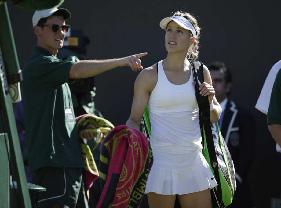 Eugenie Bouchard of Canada leaves the court after losing to Ying-Ying Duan of China in the singles first round match at the All England Lawn Tennis Championships in Wimbledon, London, Tuesday June 30, 2015. (AP Photo/Pavel Golovkin)