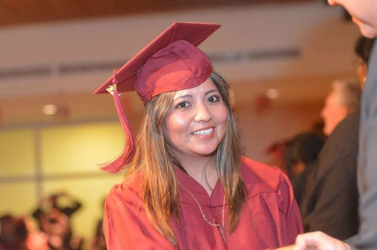 Hour Photo/Alex von Kleydorff Rene Inca gets her diploma at Norwalk Adult Ed graduation