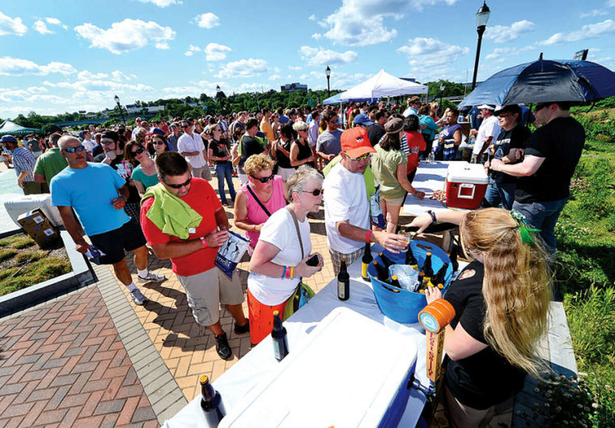 Hour photo / Erik Trautmann Nearly 500 people enjoy 18 different craft breweries from around new england poured more than 50 different beers at Ninety9 Bottles' first ever Craft Beer Festival at Oyster Shell Park Saturday.