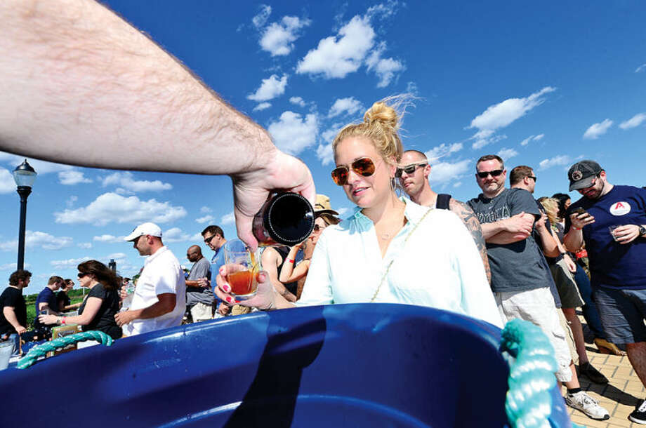 Hour photo / Erik Trautmann Nearly 500 people including Heather Varco enjoys one of 18 different craft breweries that poured more than 50 different beers at Ninety9 Bottles' first ever Craft Beer Festival at Oyster Shell Park Saturday.