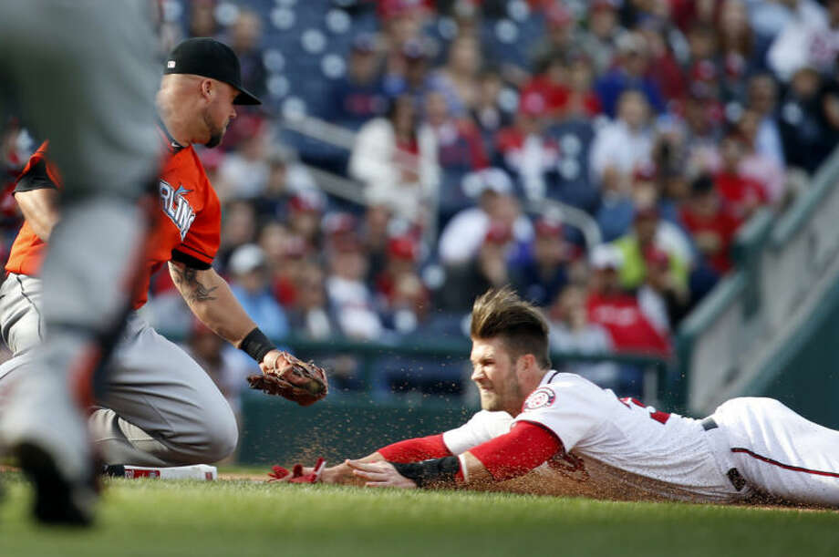 FILE - In this April 10, 2014, file photo, Washington Nationals' Bryce Harper slides safely into third as Miami Marlins third baseman Casey McGehee can't make the tag in time during the fourth inning of a baseball game at Nationals Park in Washington. Harper, Yasiel Puig of the Dodgers and Josh Hamilton of the Angels are among several stars who have gotten hurt sliding that way this year. (AP Photo/Alex Brandon, File)