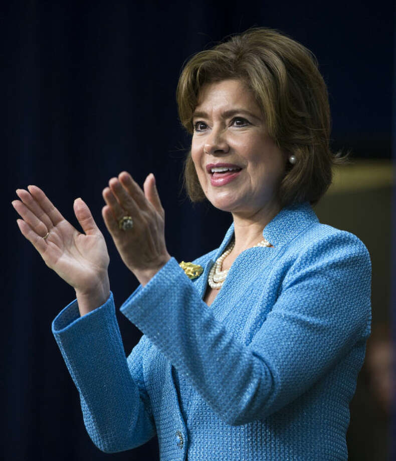 FILE - In this April 7, 2014 file photo, Maria Contreras-Sweet applauds during her ceremonial swearing in as Administrator of the Small Business Administration, in the South Court Auditorium on the White House complex in Washington. Two months into her tenure as SBA head, Contreras-Sweet wants the agency to find new ways of communicating with owners. She wants it to make loans easier and faster to get. (AP Photo/Evan Vucci, File)