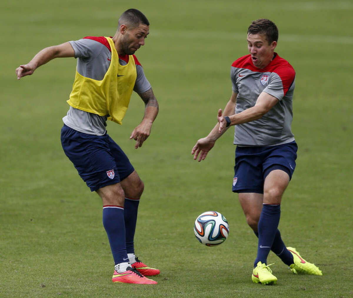 United States' Clint Dempsey, left, and Matt Besler compete for the ball during a training session at the Sao Paulo FC training center in Sao Paulo, Brazil, Wednesday, June 11, 2014. The U.S. will play in group G of the 2014 soccer World Cup. (AP Photo/Julio Cortez)
