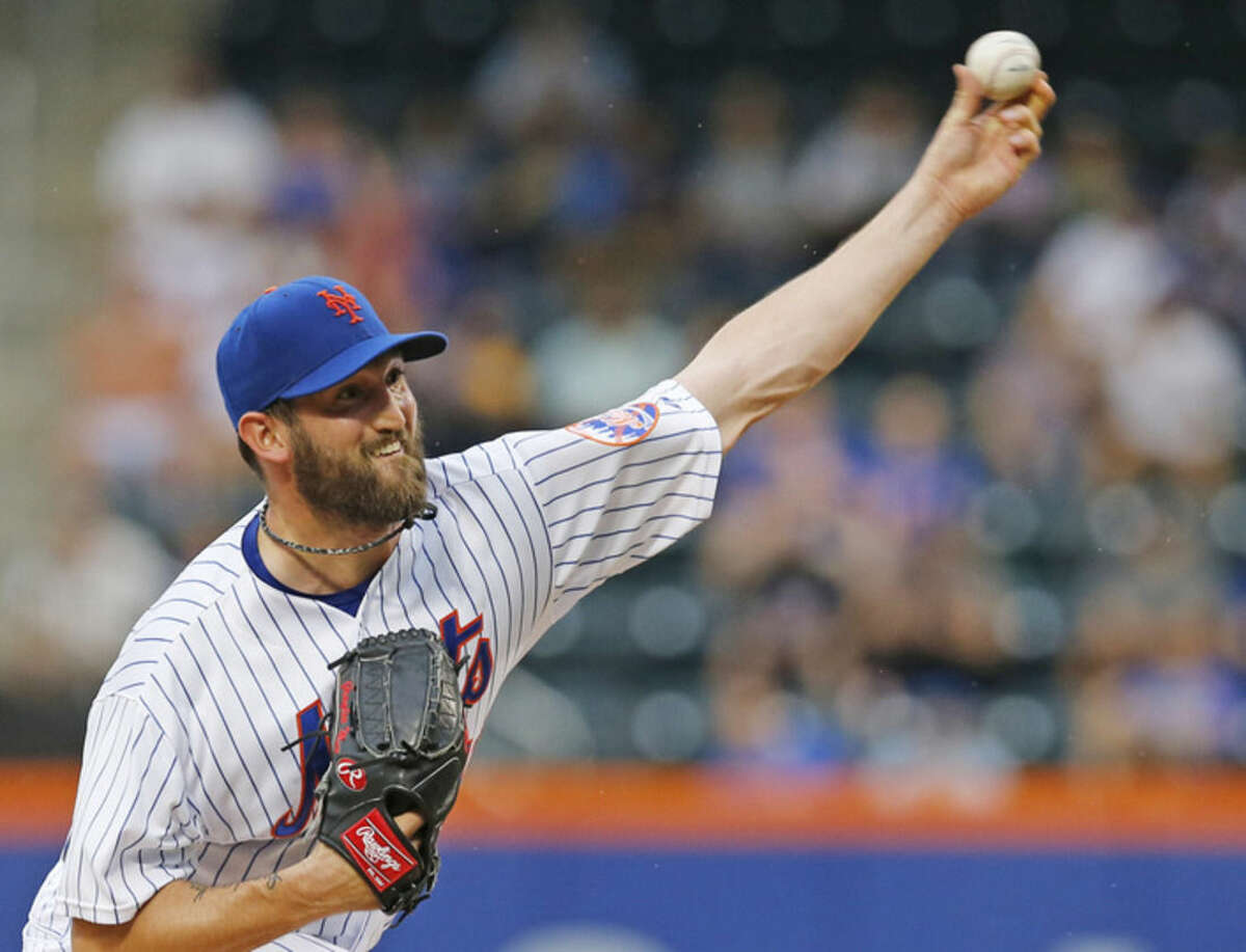 New York Mets starting pitcher Jonathon Niese delivers in the first inning of a baseball game against the Chicago Cubs in New York, Tuesday, June 30, 2015. (AP Photo/Kathy Willens)