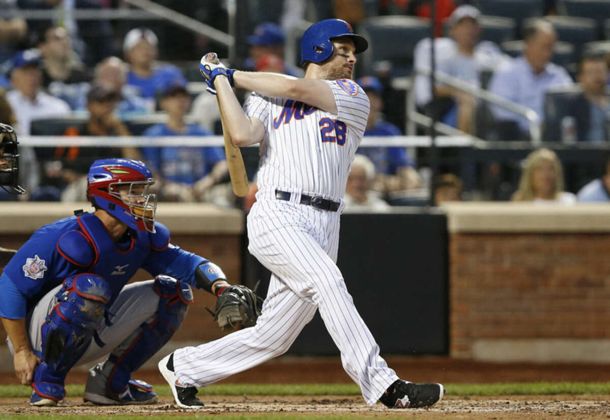 Appearing in his first game since returning from the DL, New York Mets Daniel Murphy follows through on a fourth-inning double in a baseball game against the Chicago Cubs in New York, Tuesday, June 30, 2015. (AP Photo/Kathy Willens)