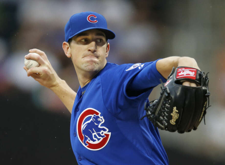 Chicago Cubs starting pitcher Kyle Hendricks (28) delivers in the first inning of a baseball game against the New York Mets in New York, Tuesday, June 30, 2015. (AP Photo/Kathy Willens)
