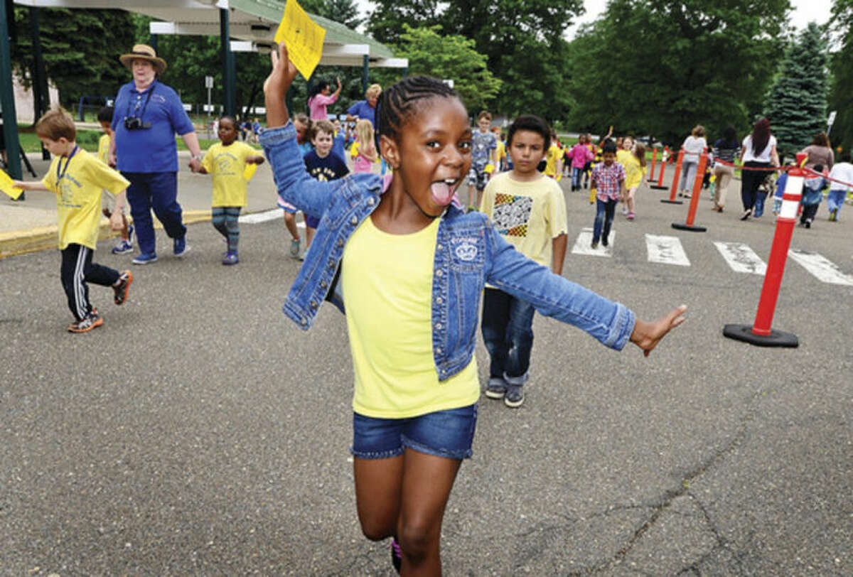 Second-grader Layla Abraham walks with her class as Fox Run Elementary School holds its annual fundraising walkathon.