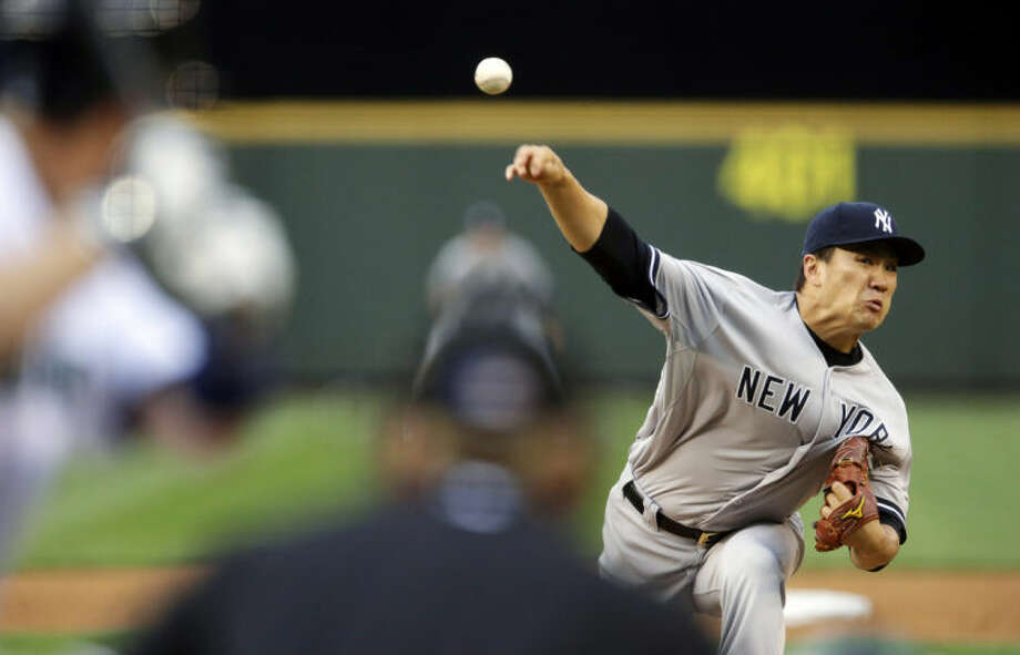 New York Yankees starting pitcher Masahiro Tanaka throws against the Seattle Mariners in the fourth inning of a baseball game, Wednesday, June 11, 2014, in Seattle. (AP Photo/Ted S. Warren)