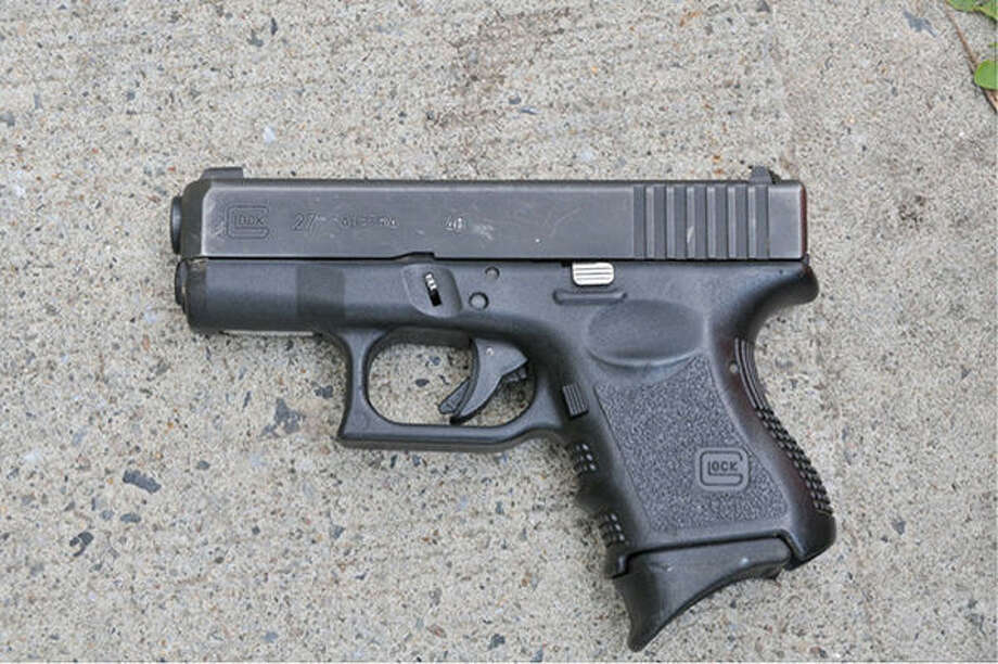Contributed photoStamford police say this .40 caliber Glock, which was fully loaded, was used in a grocery store robbery Wednesday.