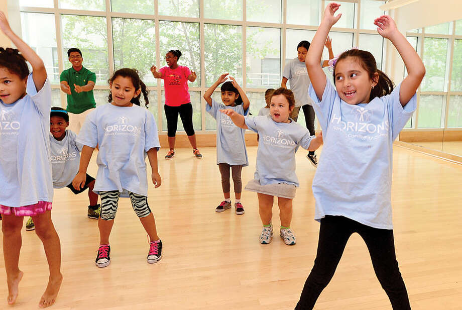 Hour photo / Erik Trautmann Kindergartner Valeria Pena and her class at Norwalk Community College's Horizons International program, a summer program focused on academics and enrichment, participates in a Zumba class Wednesday. The Horizons program is designed to encourage students from a diverse low-income population to explore new worlds and to realize their full potential.