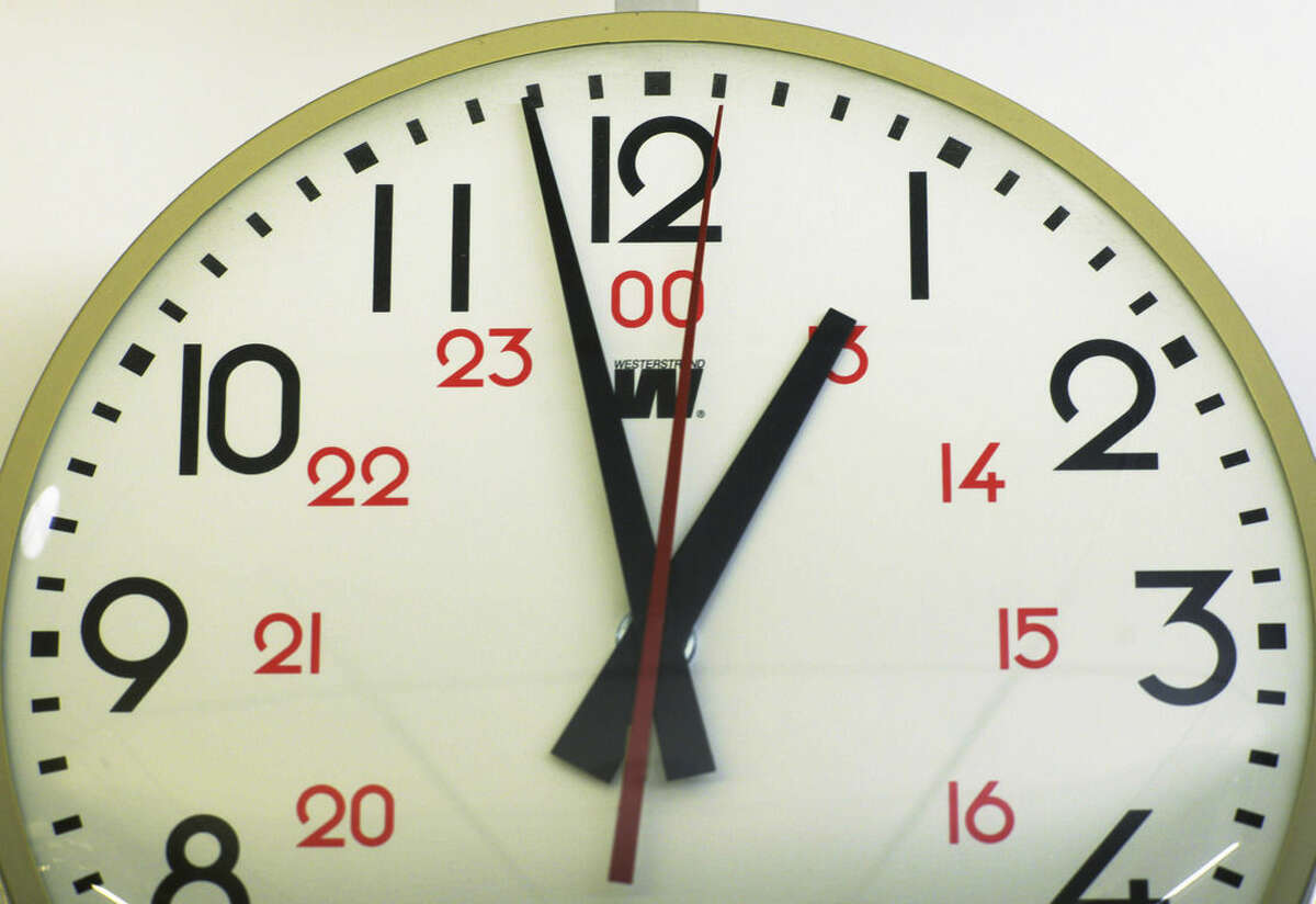 This Tuesday, June 30, 2015 photo shows the second hand of a clock at the one second mark in New York. On Tuesday, international timekeepers are tacking a second to the clock to compensate for a slightly slower Earth rotation. The leap second means clocks will move from 11:59:59 p.m. universal time to the odd reading of 11:59:60 p.m. before it hits midnight. (AP Photo/Patrick Sison)