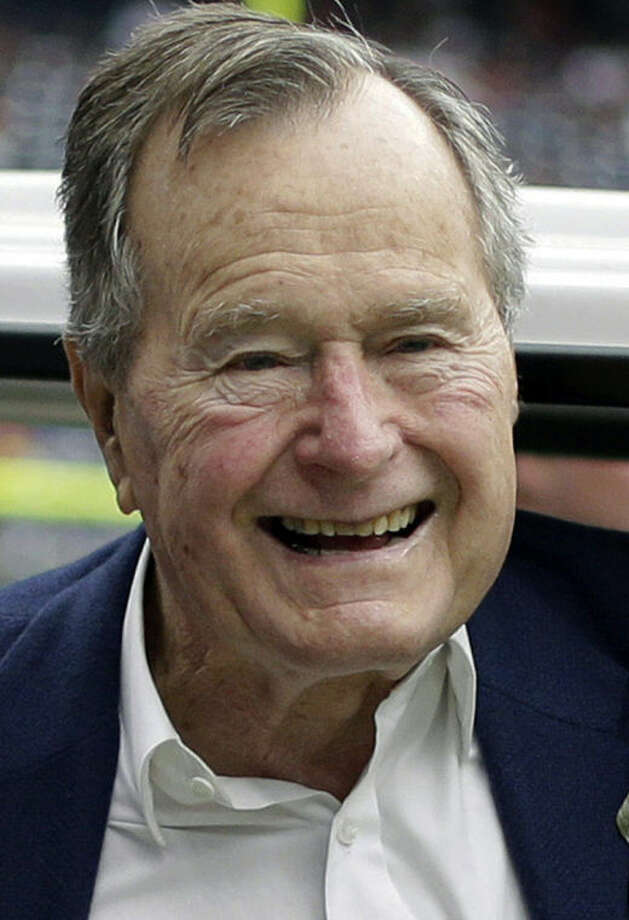 FILE - In this Nov. 4, 2012 file photo, former president George H.W. Bush pauses for a photo before an NFL football game in Houston between the Buffalo Bills and the Houston Texans. Former President George H.W. Bush is celebrating his 90th birthday in Maine. Thursday June 12, 2014. A family spokesman says a private dinner Thursday evening features a guest list of more than 200 friends and relatives. (AP Photo/Eric Gay, File)