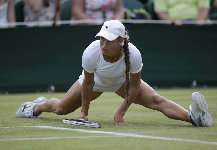 Yulia Putintseva of Kazakhstan falls to ground as she plays Venus Williams of the United States, during their singles match at the All England Lawn Tennis Championships in Wimbledon, London, Wednesday July 1, 2015. (AP Photo/Pavel Golovkin)