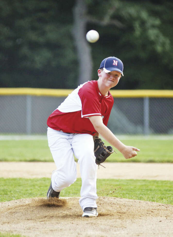 Hour photo/Danielle CallowayNorwalk's Brandon Frederique , pitches against Darien American on Wednesday.