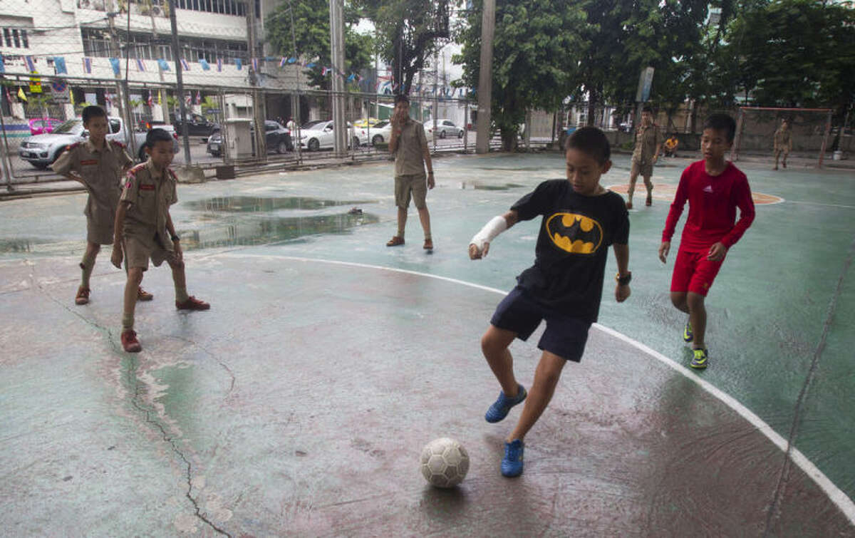 Thai students play soccer under an expressway in Bangkok, Thailand, Thursday, June 12, 2014. The junta that overthrew Thailand's elected government has struck a blow for freedom ?- the freedom to watch soccer. On Thursday, the National Broadcasting and Telecoms Commission announced it had struck a 427 million baht ($13 million) compensation deal with RS so the entire World Cup can be shown on free channels. (AP Photo/Sakchai Lalit)